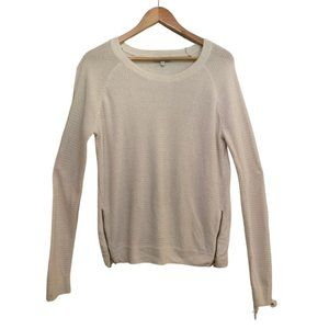 White waffle knit sweater with gold zippers